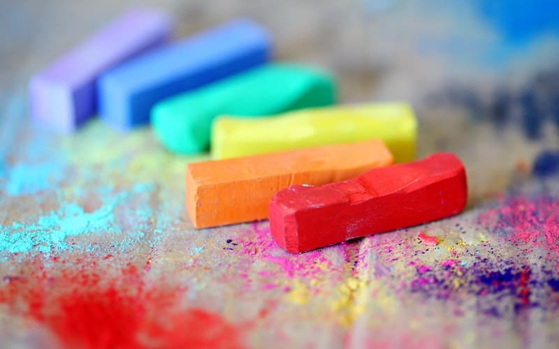 colorful pieces of chalk on cardboard