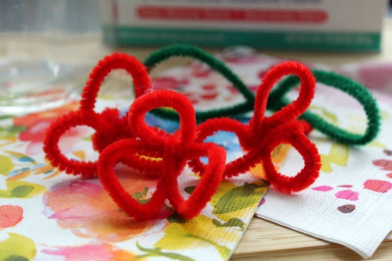 red and green pipe cleaners shaped like flowers